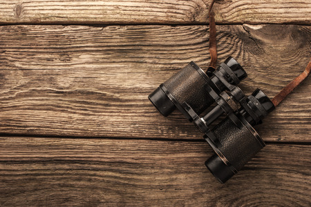 approximation: Binoculars on the wooden table Stock Photo