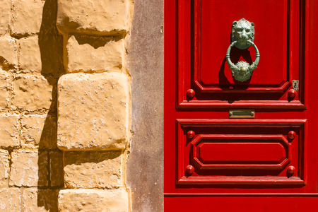 Red maltese door with  old forged handle