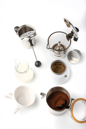 milk cans: Equipment for preparation coffee  on the white background vertical Stock Photo