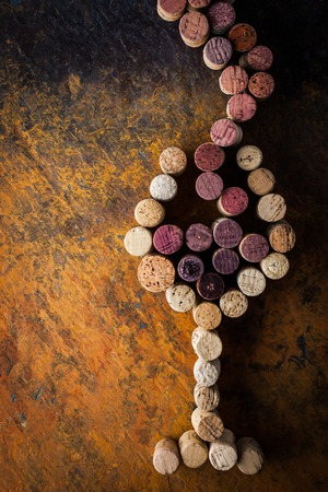 winy: Glass of wine made by cork on the colorful background Stock Photo