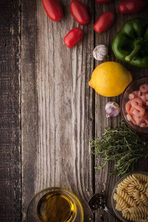 tomato: Vegetable with seasoning , shrimps and pasta on the wooden table top view