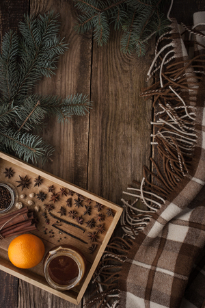 cuisine entertainment: Orange , honey and spices on the wooden tray  with plaid vertical Stock Photo