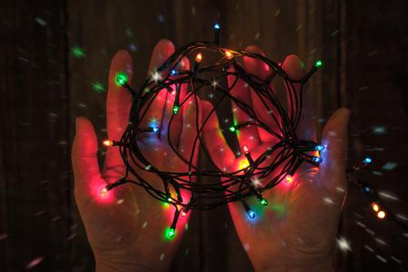 festoon: Shining colorful festoon in the hands
