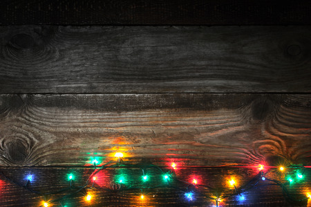 Colorful festoon on the wooden board Stock Photo