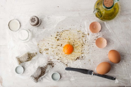 coking: Broken egg with herbs mix and olive oil