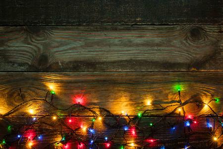 festoon: Colorful festoon on the wooden board Stock Photo