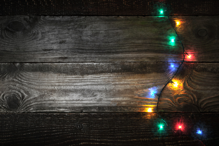 festoon: Colorful festoon at the right of the wooden board