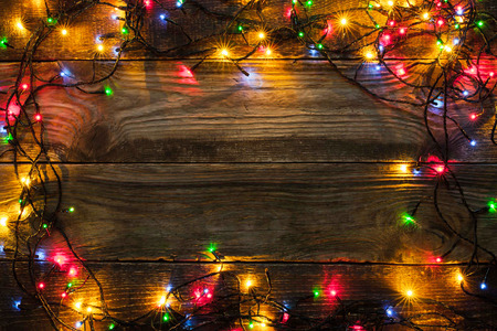 festoon: Frame of the colorful Christmas festoon on the wooden board Stock Photo