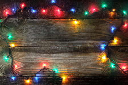 festoon: Frame of the colorful festoon on the wooden board Stock Photo