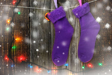 morado: Christmas socks on the clothespins with candy Foto de archivo