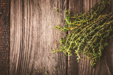 piquancy: Bundle of thyme on the wooden board top view