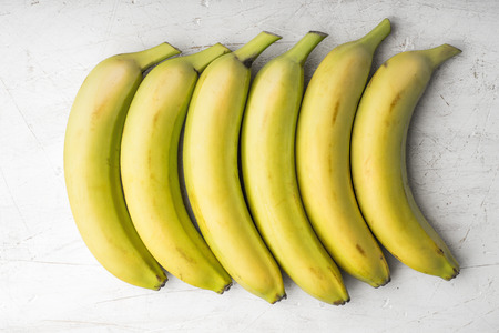 rectangle: Yellow bananas are laid out in a rectangle horizontal