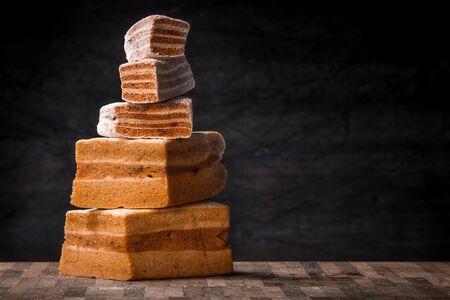 pastila: Pyramid of pastila pieces on the wooden table horizontal