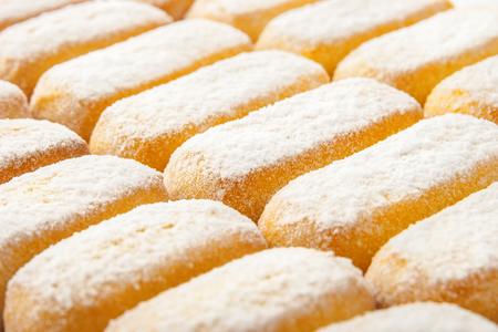 powdered sugar: Cookies with powdered sugar background horizontal