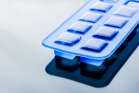 Ice cube tray with ice horizontal Stock Photo