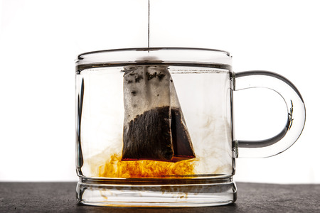 Glass cup with water and tea bag  horizontal