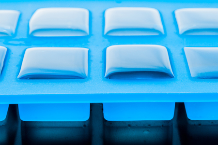 refrigerate: Ice cube tray with ice close-up