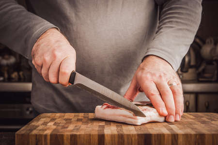 lard: Man cutting lard