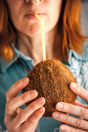 blue hawaiian drink: Woman drinking coconut milk