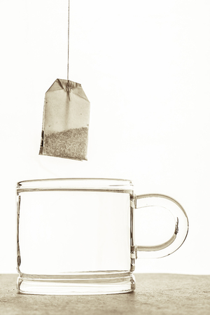 tea bag: Tea bag with cup of water  on the white background