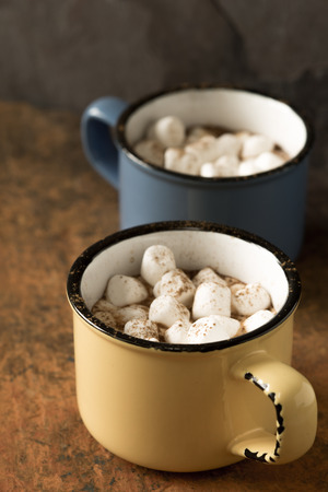 delirious: Cups of cocoa with marshmallows vertical