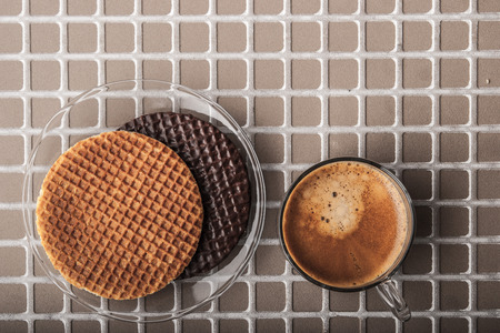 crimp: Wafers with cup of coffee on the relief background top view