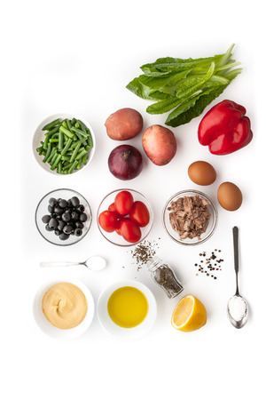 Ingredients for Nicoise salad on the white background