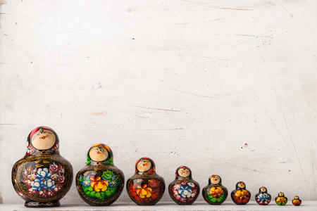 matreshka: Matreshka set on the white scratched background Stock Photo