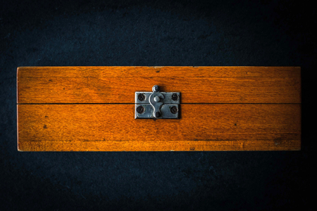metal fastener: Wooden box on the dark stone table