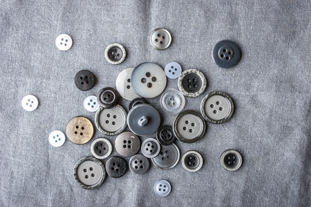 findings: Buttons on the fabric black and white top view