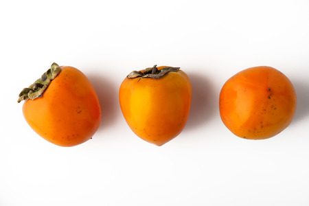astringent: Persimmons on the white background horizontal