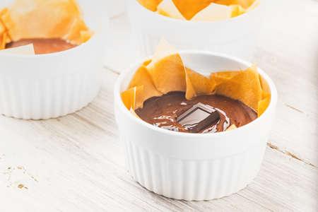 ramekin: Chocolate mass for fondant in the ramekin horizontal Stock Photo