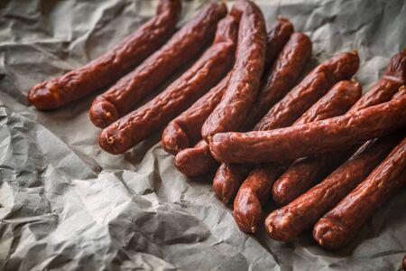 chorizo: Many smoked sausage Chorizo on a background of paper horizontal Stock Photo