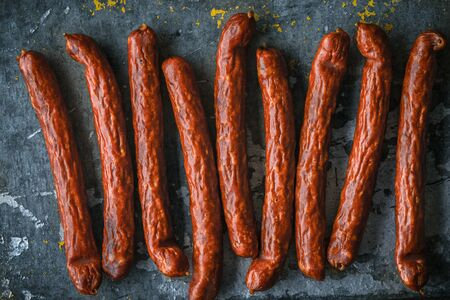 blue metallic background: Smoked sausage on a blue metallic background horizontal Stock Photo