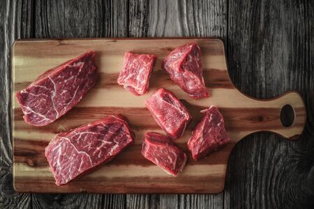 angus: Raw angus beef slices on the wooden board