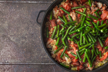 french bean: French bean on the pan with cooking paella, top view