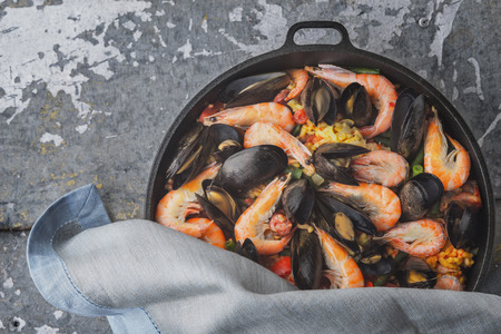 french bean: Paella in the pan on the metal background, top view