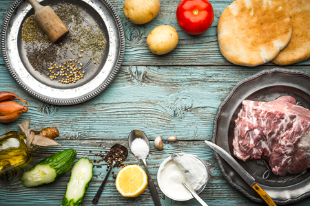 gyros: Ingredients for Gyros on the blue board Stock Photo