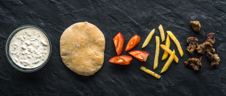 gyros: Ready-made ingredients for Gyros on black stone Stock Photo