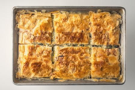 fillo: Greek pie spanakopita in the metal pan top view