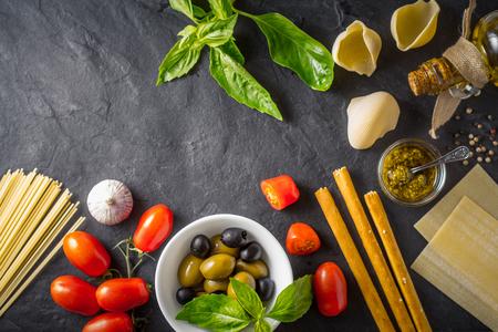 food still: Italian food still life on the dark table top view