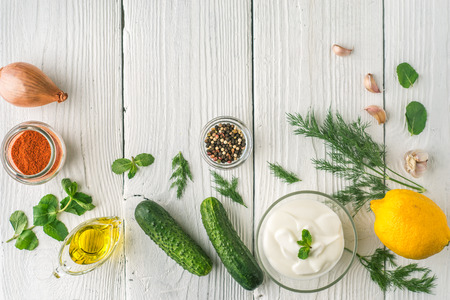 tzatziki: Ingredients for tzatziki on the white wooden table  top view