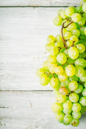 Grapes on the white wooden table