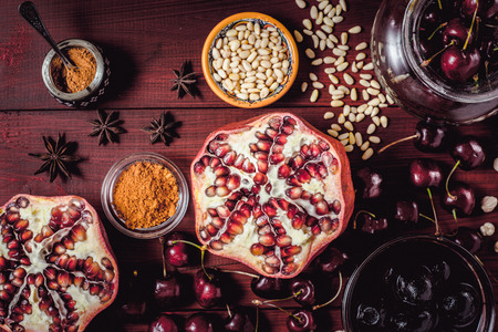 Different fruit and spices on the red wooden table. Concept of oriental fruits top view Stock Photo