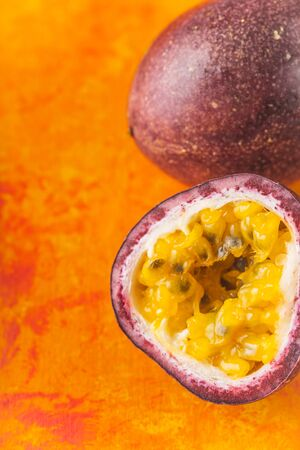 Passion fruit on the terracotta background vertical