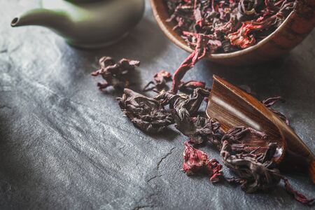convolute: Set for hibiscus tea  preparation on the dark stone table