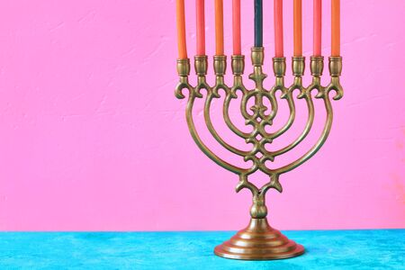 Hanukkah menorah with candles on the pink background horizontal Stock Photo