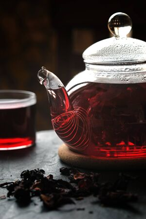 convolute: Tea in the glass teapot on the stone table vertical Stock Photo