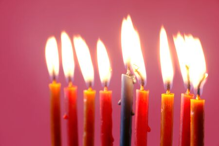 observance: Hanukkah  burning candles on the pink background Stock Photo
