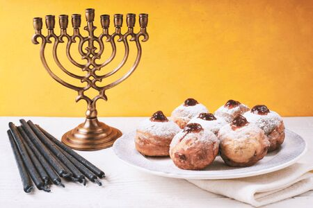 Hanukkah still life with menorah and sufganiot Stock Photo